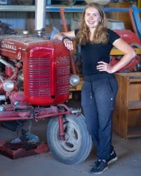 Kaylee Pillon with a Tractor